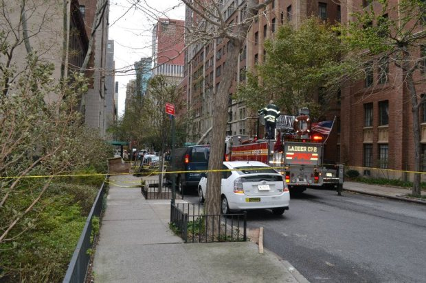 The day after Sandy hit New York, fire fighters are removing fallen trees and debris.