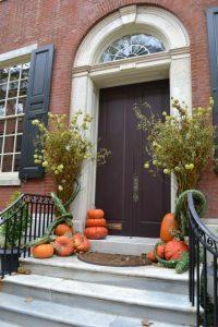 NYC pumpkins beautifully adorn stoops.